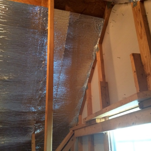Radiant barrier for cooling the windowless garage